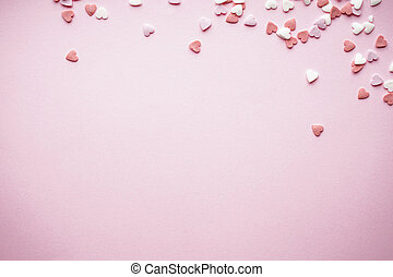 Hearts on a pink background, with space for text. Valentine's Day. Love concept. Mother's day background.
