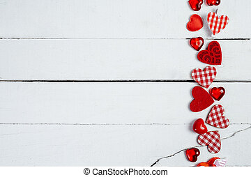 Hearts on white wood background