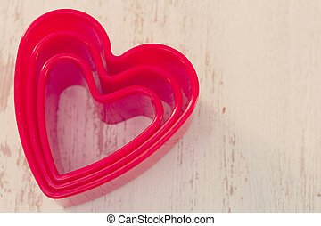 hearts on white wooden background