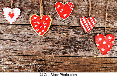 Hearts on wooden background. Valentine's day