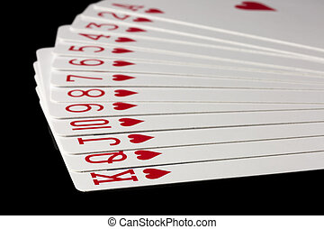 Hearts Playing Cards Spread Out on black background.