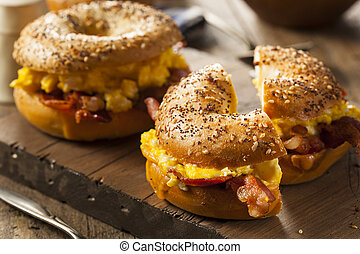 Hearty Breakfast Sandwich on a Bagel with Egg Bacon and ...