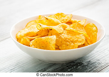 Hearty potato chips in a bowl