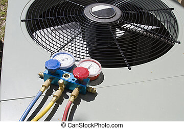 heat pump maintenance - outside portion of HVAC heat pump...