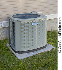 Heating and cooling unit on the side of a residential house