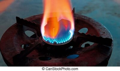 Heating coconut coals on a gas burner close-up timelapse video