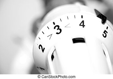heating costs - Radiator thermostat in black and white