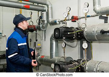 heating engineer in boiler room - maintenance engineer ...