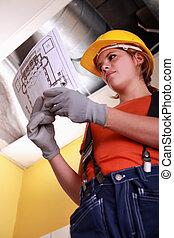 Heating engineer looking at a diagram
