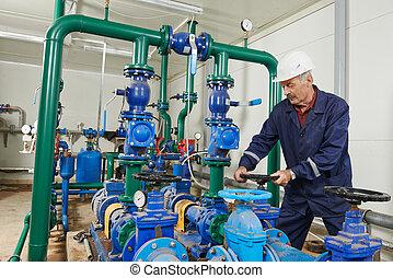 heating engineer repairman in boiler room - repairman...
