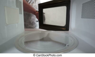 Heating frozen cheese soup container in the microwave oven