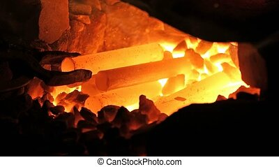 Heating of metal parts in blacksmith furnace - Metal parts...