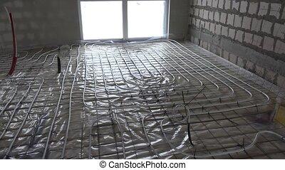 Heating pipelines on indoor floor. Rooms without walls....