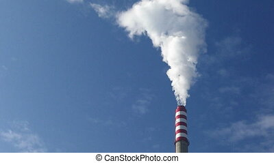 Heating plant chimney - White smoke clouds from a high...
