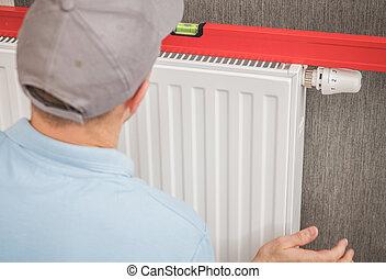 Heating Radiator Installation with Spirit Level Tool
