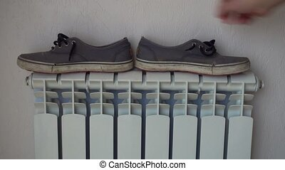 Heating radiator. Shoes, keds, drying after rain. - Heating...