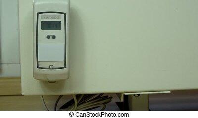 Heating sensor on modern radiator. Numbers changing on electronic device.