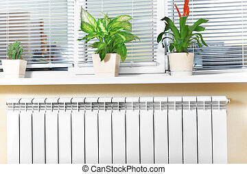 Heating white radiator radiator with flower and window. - ...