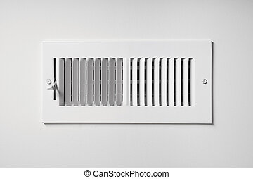 Heating/Cooling Vent - A heating/cooling vent register on...