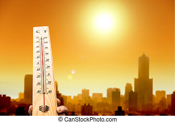 heatwave in the city and hand showing thermometer - heat ...