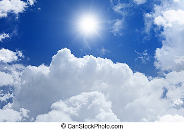 Peaceful background - bright sun in blue sky with white clouds, heaven