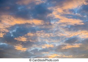 Cloudy sky illuminated by sunset sunlight