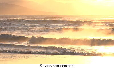 Resplendent and beautiful, the sun casts golden light over the waves of Kachemak Bay.