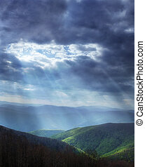 Heavenly light - Sun rays shining through stormy clouds
