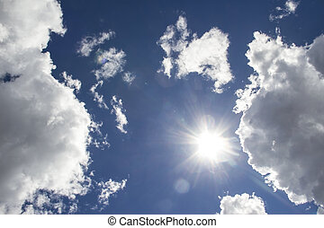 heavenly sky between the white clouds and the radiant sun