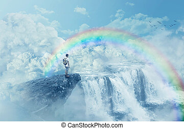 heaven's waterfall - Young boy on a cliff looking at the...
