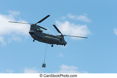 Heavy airlift military helicopter in flight.