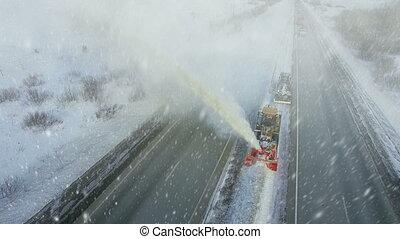 Heavy big storm snow fall, grader clean remove snow,...