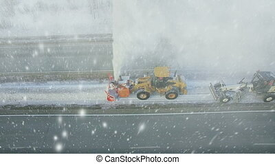 Heavy big storm snow fall, grader clean remove snow,...