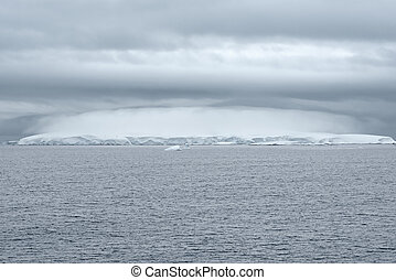 Heavy Cloud Formation Above An Iceberg in Nimrod Passage, Antarctic Peninsula, Antarctica