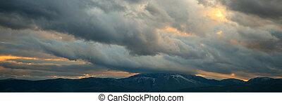 Heavy clouds over mountains