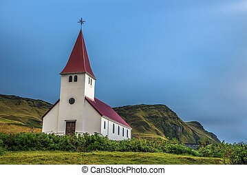 Heavy clouds over the lutheran church in Vik, Iceland