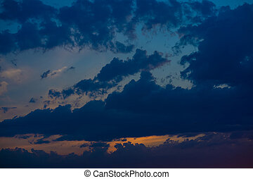 Heavy cloudy sky at sunset. A landscape of beautiful nature