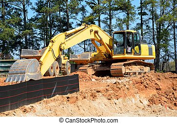 Earth mover at road construction site Georgia, USA.