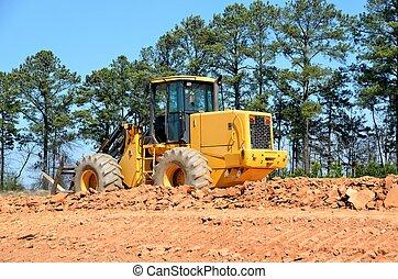 Heavy construction equpment at road construction site Georgia, USA.