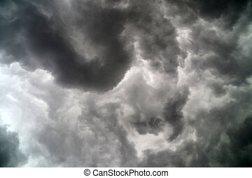 Heavy dark clouds in the sky - Clouds are actually white or...