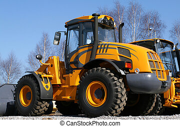 New, shiny and modern orange dozer machine. Construction industry machinery.