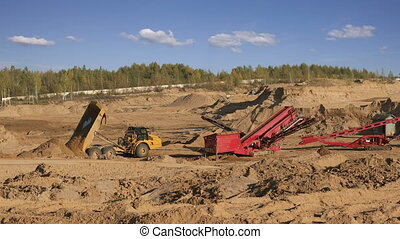 Heavy dump trucks working in the quarry sand - Quarry sand...