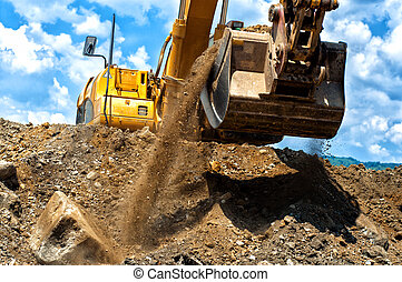 heavy duty construction excavator moving earth and sand - ...