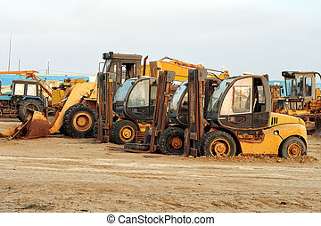 Heavy duty construction machinery on a construction site or ...