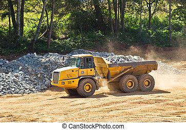 heavy duty dump truck with rock box hauling crushed rock