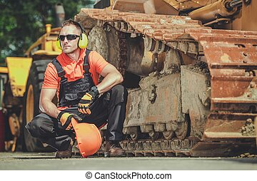 Heavy Duty Equipment Mechanic Side by Side with Aged ...