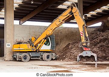 Heavy duty excavator doing earth mo