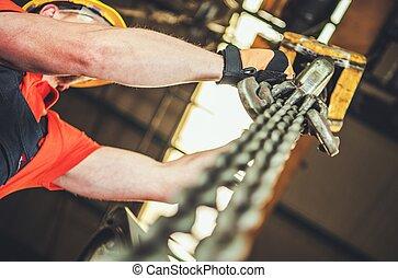 Heavy Duty Lift Operator - Caucasian Heavy Duty Chain Lift ...