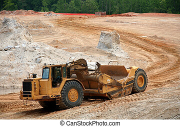 Heavy earth mover at a construction site