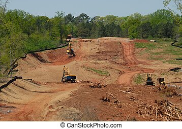road and highway construction site - Heavy equipment at road...